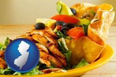 new-jersey map icon and a Mexican restaurant salad