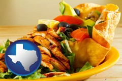 texas map icon and a Mexican restaurant salad